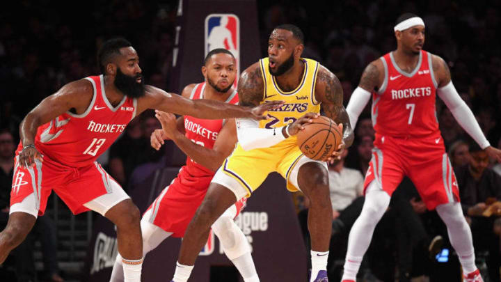 LeBron James #23 of the Los Angeles Lakers handles the ball against James Harden #13, Eric Gordon #10, and Carmelo Anthony #7 of the Houston Rockets (Photo by Harry How/Getty Images)