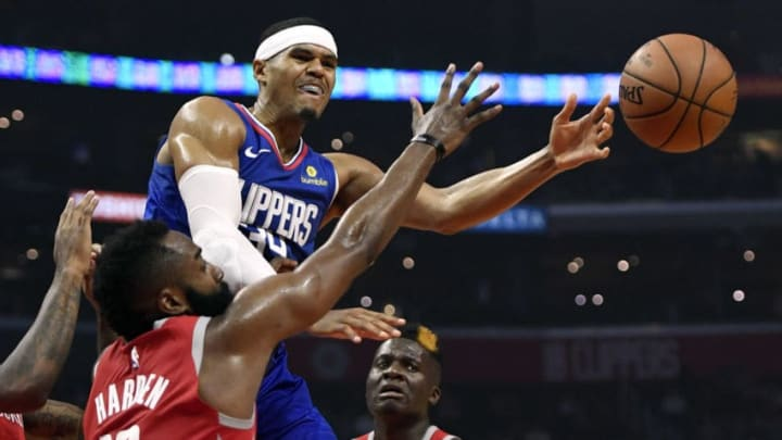 LOS ANGELES, CA - OCTOBER 21: Tobias Harris #34 of the Los Angeles Clippers throws a pass against James Harden #13 of the Houston Rockets during the first half of a basketball game at Staples Center on October 21, 2018 in Los Angeles, California. NOTE TO USER: User expressly acknowledges and agrees that, by downloading and or using this photograph, User is consenting to the terms and conditions of the Getty Images License Agreement. (Photo by Kevork Djansezian/Getty Images)