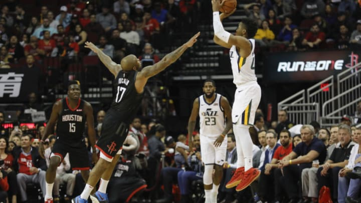 PJ Tucker of the Houston Rockets defends Donovan Mitchell of the Utah Jazz (Photo by Tim Warner/Getty Images)