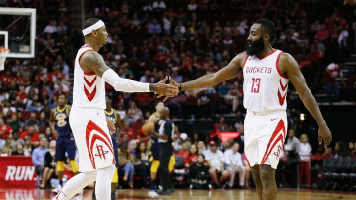 HOUSTON, TX - OCTOBER 04: James Harden #13 of the Houston Rockets shakes hands with Carmelo Anthony #7 against the Indiana Pacers at Toyota Center on October 4, 2018 in Houston, Texas. NOTE TO USER: User expressly acknowledges and agrees that, by downloading and or using this photograph, User is consenting to the terms and conditions of the Getty Images License Agreement. (Photo by Bob Levey/Getty Images)