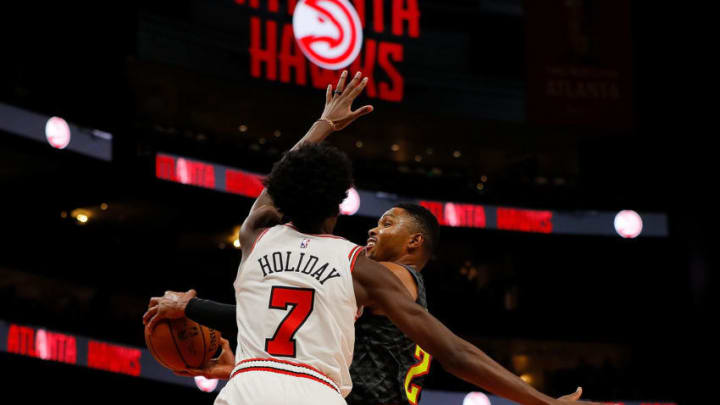 ATLANTA, GA - OCTOBER 27: Kent Bazemore #24 of the Atlanta Hawks drives against Justin Holiday #7 of the Chicago Bulls at State Farm Arena on October 27, 2018 in Atlanta, Georgia. NOTE TO USER: User expressly acknowledges and agrees that, by downloading and or using this photograph, User is consenting to the terms and conditions of the Getty Images License Agreement. (Photo by Kevin C. Cox/Getty Images)