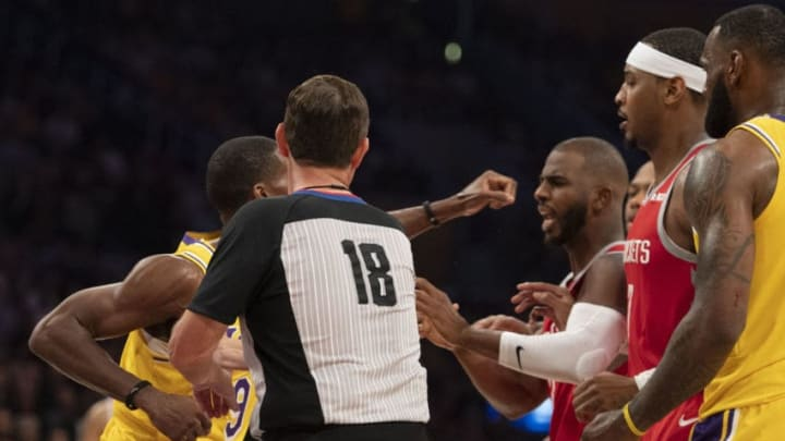 LOS ANGELES, CA - OCTOBER 20: Rajon Rondo #9 of the Los Angeles Lakers punches Chris Paul #3 of the Houston Rockets as referee Matt Boland tries to break it up during the Lakers' home opener against the Houston Rockets at Staples Center in Los Angeles on Saturday, October 20, 2018. The Los Angeles Lakers defeated the Houston Rockets 124-115. (Photo by Kevin Sullivan/Digital First Media/Orange County Register via Getty Images)