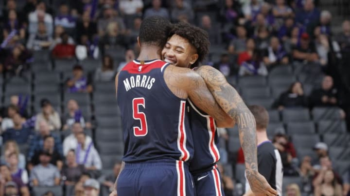 SACRAMENTO, CA - OCTOBER 26: Markieff Morris #5 of the Washington Wizards hugs teammate Kelly Oubre Jr. #12 during the game against the Sacramento Kings on October 26, 2018 at Golden 1 Center in Sacramento, California. NOTE TO USER: User expressly acknowledges and agrees that, by downloading and or using this photograph, User is consenting to the terms and conditions of the Getty Images Agreement. Mandatory Copyright Notice: Copyright 2018 NBAE (Photo by Rocky Widner/NBAE via Getty Images)
