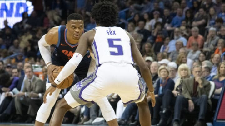 Russell Westbrook #0 of the Oklahoma City Thunder drives around De'Aaron Fox #5 of the Sacramento Kings (Photo by J Pat Carter/Getty Images)