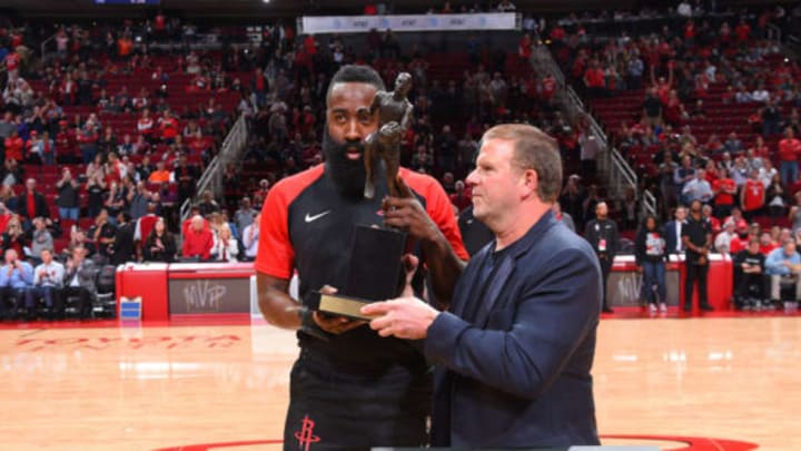 HOUSTON, TX – OCTOBER 17: James Harden #13 of the Houston Rockets is presented the Maurice Podoloff Trophy for MVP by Tilman Fertitta during a game on October 17, 2018 at Toyota Center, in Houston, Texas. NOTE TO USER: User expressly acknowledges and agrees that, by downloading and/or using this Photograph, user is consenting to the terms and conditions of the Getty Images License Agreement. Mandatory Copyright Notice: Copyright 2018 NBAE (Photo by Bill Baptist/NBAE via Getty Images)