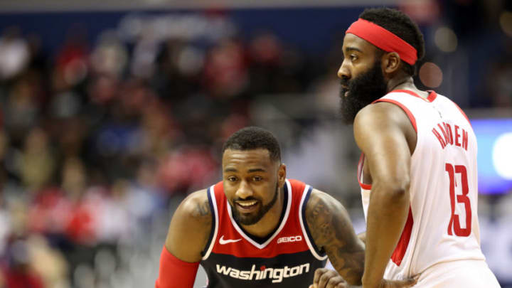 John Wall #2 of the Washington Wizards talks with James Harden #13 of the Houston Rockets (Photo by Rob Carr/Getty Images)