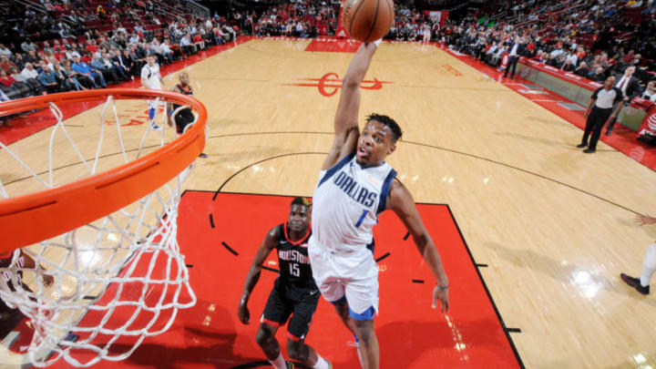 HOUSTON, TX - NOVEMBER 28: Dennis Smith Jr. #1 of the Dallas Mavericks dunks the ball against the Houston Rockets on November 28, 2018 at the Toyota Center in Houston, Texas. NOTE TO USER: User expressly acknowledges and agrees that, by downloading and or using this photograph, User is consenting to the terms and conditions of the Getty Images License Agreement. Mandatory Copyright Notice: Copyright 2018 NBAE (Photo by Bill Baptist/NBAE via Getty Images)
