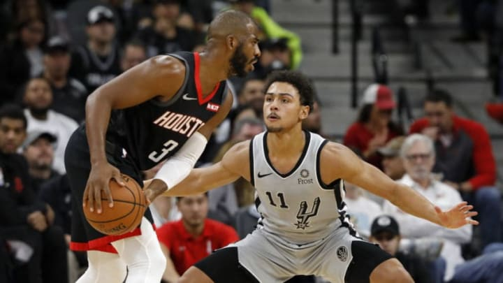 SAN ANTONIO, TX - NOVEMBER 30: Chris Paul #3 of the Houston Rockets looks for around Bryn Forbes #11 of the San Antonio Spurs during an NBA game held November 30, 2018 at the AT&T Center in San Antonio, Texas. NOTE TO USER: User expressly acknowledges and agrees that, by downloading and or using this photograph, User is consenting to the terms and conditions of the Getty Images License Agreement. (Photo by Edward A. Ornelas/Getty Images)