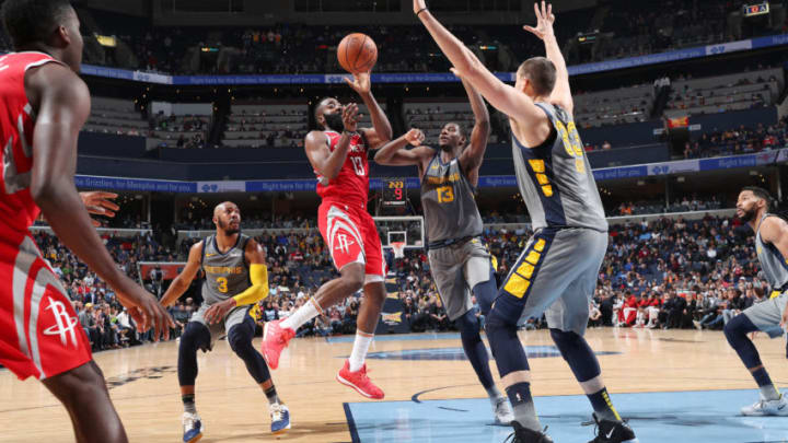 MEMPHIS, TN - DECEMBER 15: James Harden #13 of the Houston Rockets passes the ball against the Memphis Grizzlies on December 15, 2018 at FedExForum in Memphis, Tennessee. NOTE TO USER: User expressly acknowledges and agrees that, by downloading and or using this photograph, User is consenting to the terms and conditions of the Getty Images License Agreement. Mandatory Copyright Notice: Copyright 2018 NBAE (Photo by Joe Murphy/NBAE via Getty Images)