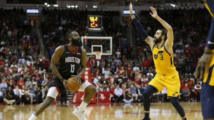HOUSTON, TX - DECEMBER 17: James Harden #13 of the Houston Rockets pulls up to take a three point shot defended by Ricky Rubio #3 of the Utah Jazz in the second half at Toyota Center on December 17, 2018 in Houston, Texas. NOTE TO USER: User expressly acknowledges and agrees that, by downloading and or using this photograph, User is consenting to the terms and conditions of the Getty Images License Agreement. (Photo by Tim Warner/Getty Images)