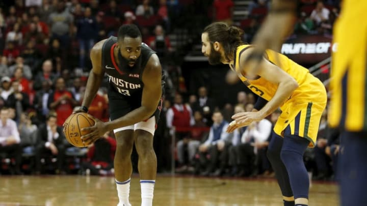 James Harden #13 of the Houston Rockets controls the ball defended by Ricky Rubio #3 of the Utah Jazz (Photo by Tim Warner/Getty Images)