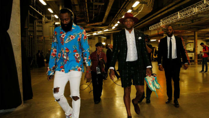 MIAMI, FL - DECEMBER 20: James Harden #13 and PJ Tucker #17 of the Houston Rockets arrive prior to the game between the Miami Heat and the Houston Rockets at American Airlines Arena on December 20, 2018 in Miami, Florida. NOTE TO USER: User expressly acknowledges and agrees that, by downloading and or using this photograph, User is consenting to the terms and conditions of the Getty Images License Agreement. (Photo by Michael Reaves/Getty Images)