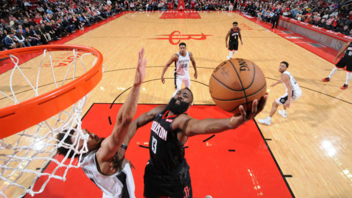 HOUSTON, TX - DECEMBER 22: James Harden #13 of the Houston Rockets goes to the basket against the San Antonio Spurs on December 22, 2018 at the Toyota Center in Houston, Texas. NOTE TO USER: User expressly acknowledges and agrees that, by downloading and/or using this photograph, user is consenting to the terms and conditions of the Getty Images License Agreement. Mandatory Copyright Notice: Copyright 2018 NBAE (Photo by Bill Baptist/NBAE via Getty Images)