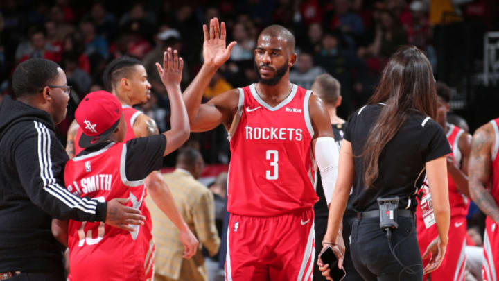 HOUSTON, TX - DECEMBER 19: Chris Paul #3 of the Houston Rockets hi-fives a fan against the Washington Wizards on December 19, 2018 at the Toyota Center in Houston, Texas. NOTE TO USER: User expressly acknowledges and agrees that, by downloading and or using this photograph, User is consenting to the terms and conditions of the Getty Images License Agreement. Mandatory Copyright Notice: Copyright 2018 NBAE (Photo by Ned Dishman/NBAE via Getty Images)