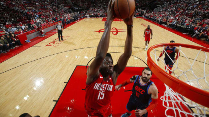 HOUSTON, TX - DECEMBER 25: Clint Capela #15 of the Houston Rockets dunks the ball during the game against the Oklahoma City Thunder on December 25, 2018 at the Toyota Center in Houston, Texas. NOTE TO USER: User expressly acknowledges and agrees that, by downloading and or using this photograph, User is consenting to the terms and conditions of the Getty Images License Agreement. Mandatory Copyright Notice: Copyright 2018 NBAE (Photo by Jeff Haynes/NBAE via Getty Images)