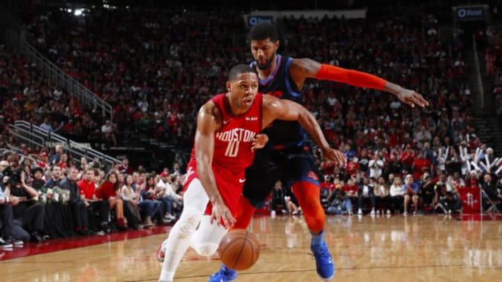 HOUSTON, TX - DECEMBER 25: Eric Gordon #10 of the Houston Rockets handles the ball during the game against the Oklahoma City Thunder on December 25, 2018 at the Toyota Center in Houston, Texas. NOTE TO USER: User expressly acknowledges and agrees that, by downloading and or using this photograph, User is consenting to the terms and conditions of the Getty Images License Agreement. Mandatory Copyright Notice: Copyright 2018 NBAE (Photo by Jeff Haynes/NBAE via Getty Images)