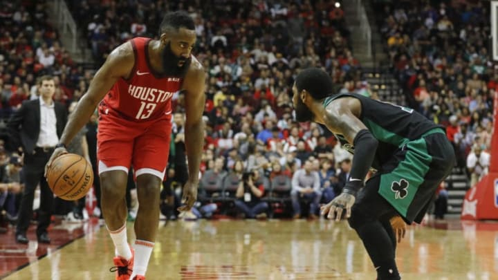 HOUSTON, TX - DECEMBER 27: James Harden #13 of the Houston Rockets controls the ball defended by Kyrie Irving #11 of the Boston Celtics in the second half at Toyota Center on December 27, 2018 in Houston, Texas. NOTE TO USER: User expressly acknowledges and agrees that, by downloading and or using this photograph, User is consenting to the terms and conditions of the Getty Images License Agreement. (Photo by Tim Warner/Getty Images)