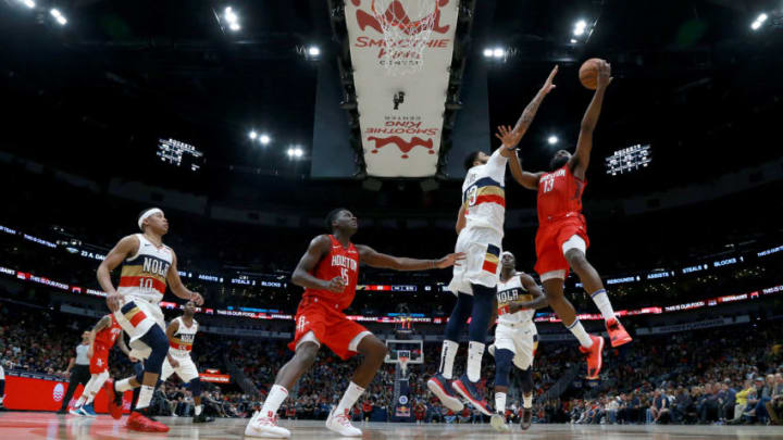 NEW ORLEANS, LOUISIANA - DECEMBER 29: James Harden #13 of the Houston Rockets shoots over Anthony Davis #23 of the New Orleans Pelicans during a NBA game at the Smoothie King Center on December 29, 2018 in New Orleans, Louisiana. NOTE TO USER: User expressly acknowledges and agrees that, by downloading and or using this photograph, User is consenting to the terms and conditions of the Getty Images License Agreement. (Photo by Sean Gardner/Getty Images)