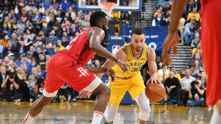 Stephen Curry #30 of the Golden State Warriors handles the ball against James Harden #13 of the Houston Rockets (Photo by Andrew D. Bernstein/NBAE via Getty Images)
