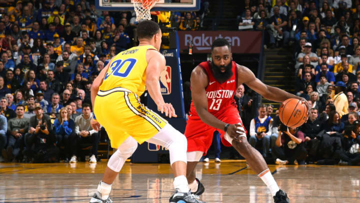 James Harden #13 of the Houston Rockets handles the ball against the Golden State Warriors (Photo by Noah Graham/NBAE via Getty Images)