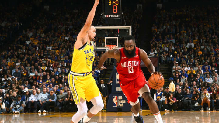 OAKLAND, CA - JANUARY 3: James Harden #13 of the Houston Rockets drives to the basket against the Golden State Warriors on January 3, 2019 at ORACLE Arena in Oakland, California. NOTE TO USER: User expressly acknowledges and agrees that, by downloading and or using this photograph, user is consenting to the terms and conditions of Getty Images License Agreement. Mandatory Copyright Notice: Copyright 2019 NBAE (Photo by Noah Graham/NBAE via Getty Images)
