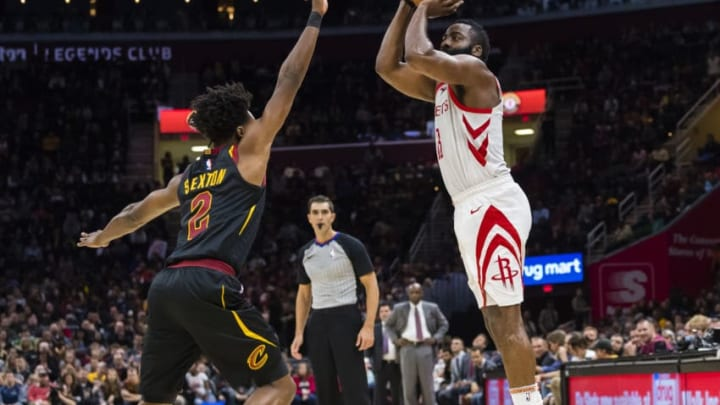 Collin Sexton #2 of the Cleveland Cavaliers attempts to block James Harden #13 of the Houston Rockets (Photo by Jason Miller/Getty Images)