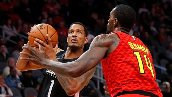 ATLANTA, GEORGIA - DECEMBER 18: Trevor Ariza #1 of the Washington Wizards drives against Dewayne Dedmon #14 of the Atlanta Hawks at State Farm Arena on December 18, 2018 in Atlanta, Georgia. NOTE TO USER: User expressly acknowledges and agrees that, by downloading and or using this photograph, User is consenting to the terms and conditions of the Getty Images License Agreement. (Photo by Kevin C. Cox/Getty Images)