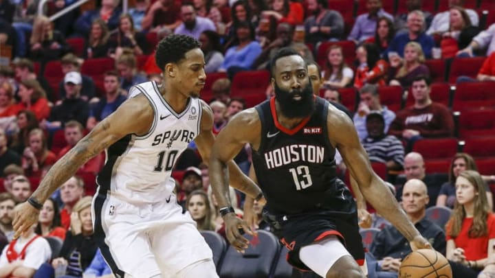 HOUSTON, TEXAS - DECEMBER 22: James Harden #13 of the Houston Rockets drives around DeMar DeRozan #10 of the San Antonio Spurs during the fourth quarter at Toyota Center on December 22, 2018 in Houston, Texas. NOTE TO USER: User expressly acknowledges and agrees that, by downloading and or using this photograph, User is consenting to the terms and conditions of the Getty Images License Agreement. (Photo by Bob Levey/Getty Images)