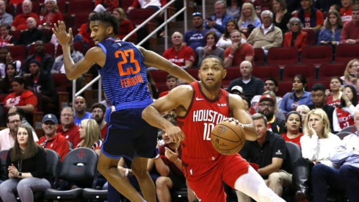 HOUSTON, TEXAS - DECEMBER 25: Eric Gordon #10 of the Houston Rockets drives around Terrance Ferguson #23 of the Oklahoma City Thunder during the first quarter at Toyota Center on December 25, 2018 in Houston, Texas. NOTE TO USER: User expressly acknowledges and agrees that, by downloading and or using this photograph, User is consenting to the terms and conditions of the Getty Images License Agreement. (Photo by Bob Levey/Getty Images)