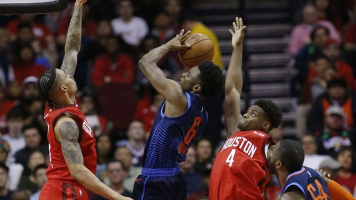 HOUSTON, TEXAS - DECEMBER 25: Hamidou Diallo #6 of the Oklahoma City Thunder shoots between Gerald Green #14 of the Houston Rockets and Danuel House Jr. #4 asPatrick Patterson #54 looks on at Toyota Center on December 25, 2018 in Houston, Texas. NOTE TO USER: User expressly acknowledges and agrees that, by downloading and or using this photograph, User is consenting to the terms and conditions of the Getty Images License Agreement. (Photo by Bob Levey/Getty Images)