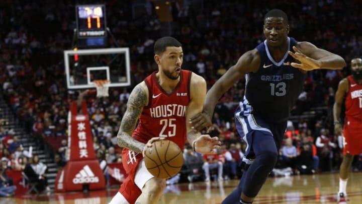 HOUSTON, TEXAS - DECEMBER 31: Austin Rivers #25 of the Houston Rockets drives past Jaren Jackson Jr. #13 of the Memphis Grizzlies during the second quarter at Toyota Center on December 31, 2018 in Houston, Texas. NOTE TO USER: User expressly acknowledges and agrees that, by downloading and or using this photograph, User is consenting to the terms and conditions of the Getty Images License Agreement. (Photo by Bob Levey/Getty Images)
