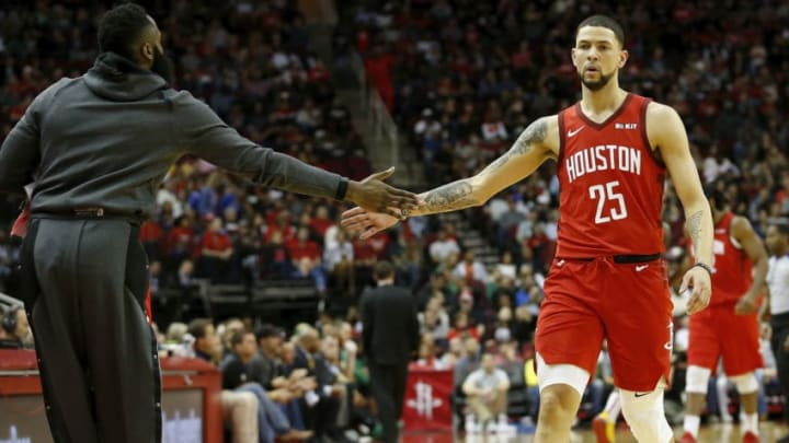 HOUSTON, TX - DECEMBER 27: James Harden #13 of the Houston Rockets congratulates Austin Rivers #25 in the first half a Boston Celtics at Toyota Center on December 27, 2018 in Houston, Texas. NOTE TO USER: User expressly acknowledges and agrees that, by downloading and or using this photograph, User is consenting to the terms and conditions of the Getty Images License Agreement. (Photo by Tim Warner/Getty Images)
