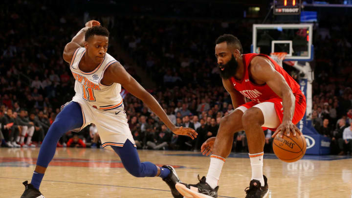 James Harden #13 of the Houston Rockets in action against Frank Ntilikina #11 of the New York Knicks