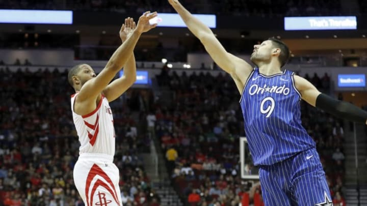 HOUSTON, TX - JANUARY 27: Nikola Vucevic #9 of the Orlando Magic blocks a three point attempt by Eric Gordon #10 of the Houston Rockets in the first half at Toyota Center on January 27, 2019 in Houston, Texas. NOTE TO USER: User expressly acknowledges and agrees that, by downloading and or using this photograph, User is consenting to the terms and conditions of the Getty Images License Agreement. (Photo by Tim Warner/Getty Images)