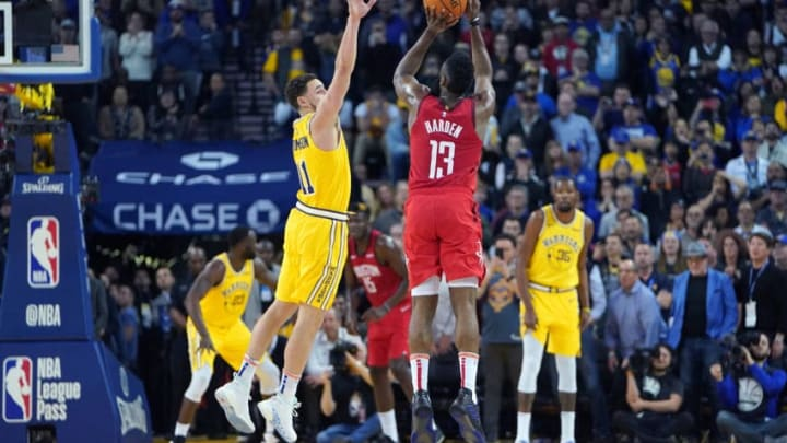 James Harden #13 of the Houston Rockets shoots over Klay Thompson #11 of the Golden State Warriors (Photo by Thearon W. Henderson/Getty Images)