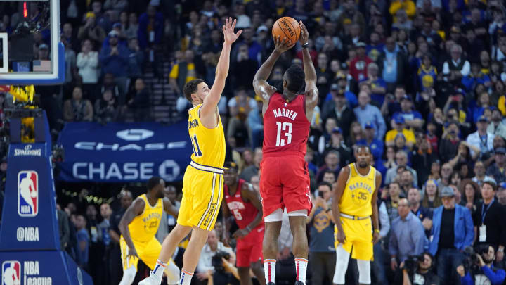 James Harden #13 of the Houston Rockets shoots over Klay Thompson #11 of the Golden State Warriors