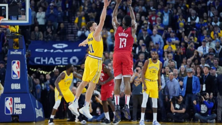 OAKLAND, CA - JANUARY 03: James Harden #13 of the Houston Rockets shoots over Klay Thompson #11 of the Golden State Warriors during an NBA basketball game at ORACLE Arena on January 3, 2019 in Oakland, California. NOTE TO USER: User expressly acknowledges and agrees that, by downloading and or using this photograph, User is consenting to the terms and conditions of the Getty Images License Agreement. (Photo by Thearon W. Henderson/Getty Images)