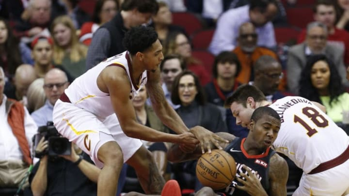 HOUSTON, TEXAS - JANUARY 11: Gary Clark #6 of the Houston Rockets fight for the loose ball with Matthew Dellavedova #18 of the Cleveland Cavaliers and Cameron Payne #3 at Toyota Center on January 11, 2019 in Houston, Texas. NOTE TO USER: User expressly acknowledges and agrees that, by downloading and or using this photograph, User is consenting to the terms and conditions of the Getty Images License Agreement. (Photo by Bob Levey/Getty Images)
