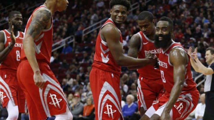 HOUSTON, TEXAS – JANUARY 14: James Harden #13 of the Houston Rockets looks to the bench as he is helped up by Gerald Green #14, Danuel House Jr. #4 and Gary Clark #6 after taking a charge during the fourth quarter against the Memphis Grizzlies at Toyota Center on January 14, 2019 in Houston, Texas. NOTE TO USER: User expressly acknowledges and agrees that, by downloading and or using this photograph, User is consenting to the terms and conditions of the Getty Images License Agreement. (Photo by Bob Levey/Getty Images)