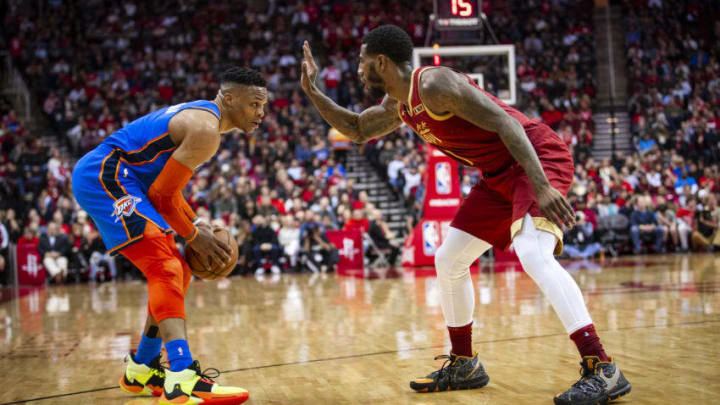 Russell Westbrook #0 of the Oklahoma City Thunder handles the ball against Iman Shumpert #1 of the Houston Rockets (Photo by Zach Beeker/NBAE via Getty Images)