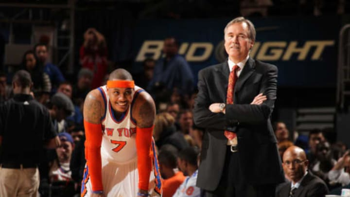 NEW YORK, NY – APRIL 12: Carmelo Anthony #7 of the New York Knicks and head coach Mike D'Antoni share a laugh during a break in the action against the Chicago Bulls on April 12, 2011 at Madison Square Garden in New York City. NOTE TO USER: User expressly acknowledges and agrees that, by downloading and or using this photograph, User is consenting to the terms and conditions of the Getty Images License Agreement. Mandatory Copyright Notice: Copyright 2011 NBAE (Photo by Nathaniel S. Butler/NBAE via Getty Images)