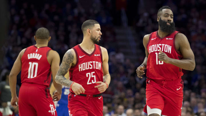 Eric Gordon #10, Austin Rivers #25, and James Harden #13 of the Houston Rockets in action against the Philadelphia 76ers