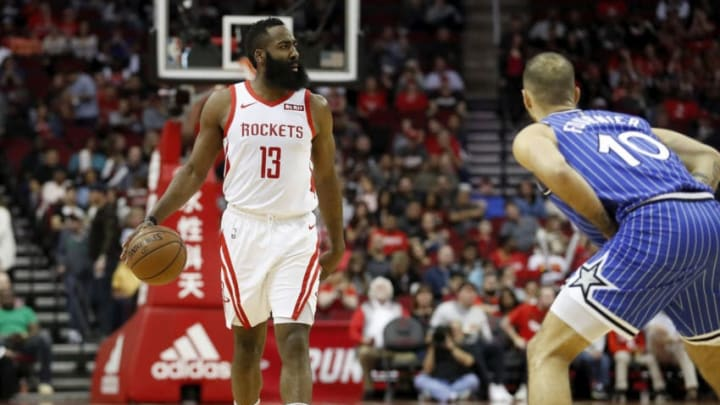 James Harden #13 of the Houston Rockets brings the ball up the court defended by Evan Fournier #10 of the Orlando Magiconsenting to the terms and conditions of the Getty Images License Agreement. (Photo by Tim Warner/Getty Images)