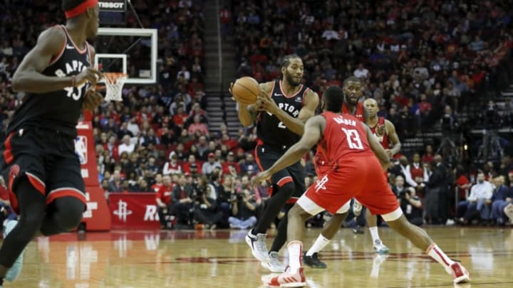 HOUSTON, TX - JANUARY 25: Kawhi Leonard #2 of the Toronto Raptors looks to pass to Pascal Siakam #43 defended by James Harden #13 of the Houston Rockets in the second half at Toyota Center on January 25, 2019 in Houston, Texas. NOTE TO USER: User expressly acknowledges and agrees that, by downloading and or using this photograph, User is consenting to the terms and conditions of the Getty Images License Agreement. (Photo by Tim Warner/Getty Images)