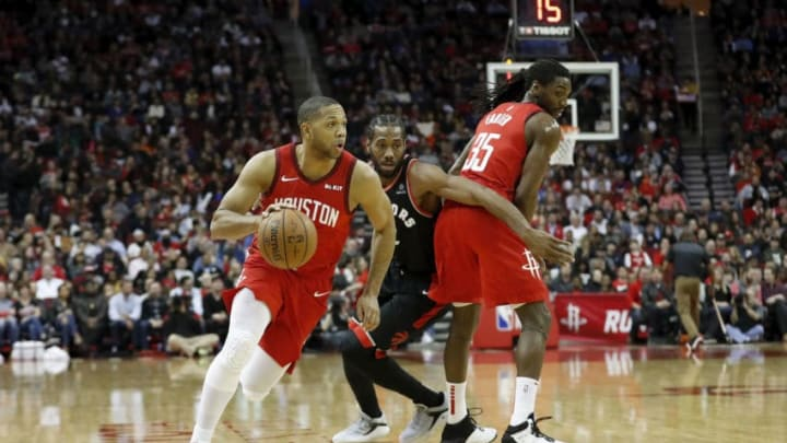 HOUSTON, TX - JANUARY 25: Eric Gordon #10 of the Houston Rockets drives to the basket defended by Kawhi Leonard #2 of the Toronto Raptors in the first half at Toyota Center on January 25, 2019 in Houston, Texas. NOTE TO USER: User expressly acknowledges and agrees that, by downloading and or using this photograph, User is consenting to the terms and conditions of the Getty Images License Agreement. (Photo by Tim Warner/Getty Images)
