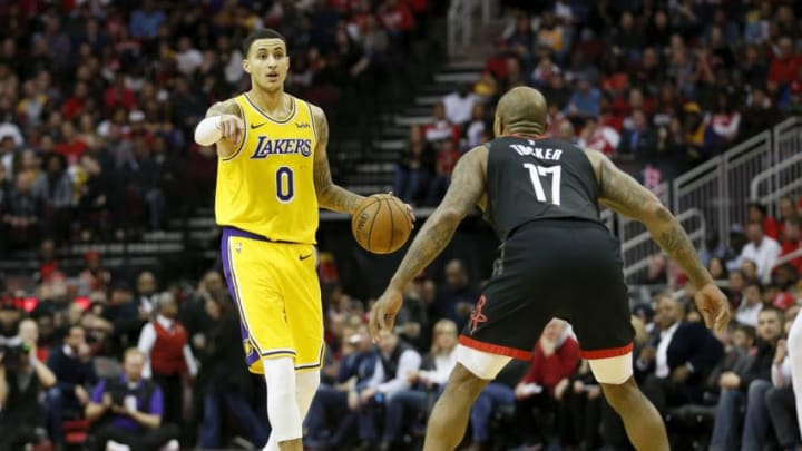Kyle Kuzma #0 of the Los Angeles Lakers brings the ball down the court defended by PJ Tucker #17 of the Houston Rockets (Photo by Tim Warner/Getty Images)