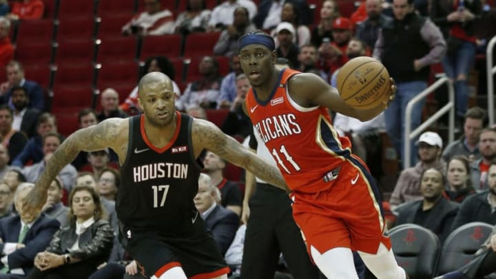 Jrue Holiday #11 of the New Orleans Pelicans drives around PJ Tucker #17 of the Houston Rockets