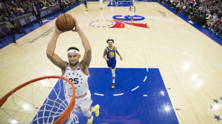 PHILADELPHIA, PA - MARCH 02: Ben Simmons #25 of the Philadelphia 76ers dunks the ball against the Golden State Warriors in the second quarter at the Wells Fargo Center on March 2, 2019 in Philadelphia, Pennsylvania. NOTE TO USER: User expressly acknowledges and agrees that, by downloading and or using this photograph, User is consenting to the terms and conditions of the Getty Images License Agreement. (Photo by Mitchell Leff/Getty Images)