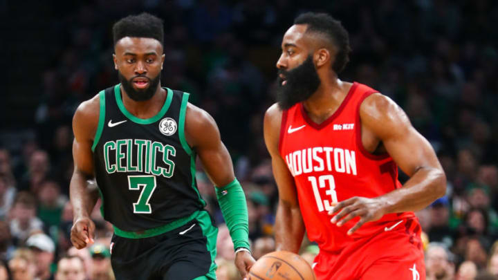 James Harden #13 of the Houston Rockets dribbles the ball past Jaylen Brown #7 of the Boston Celtics (Photo by Adam Glanzman/Getty Images)
