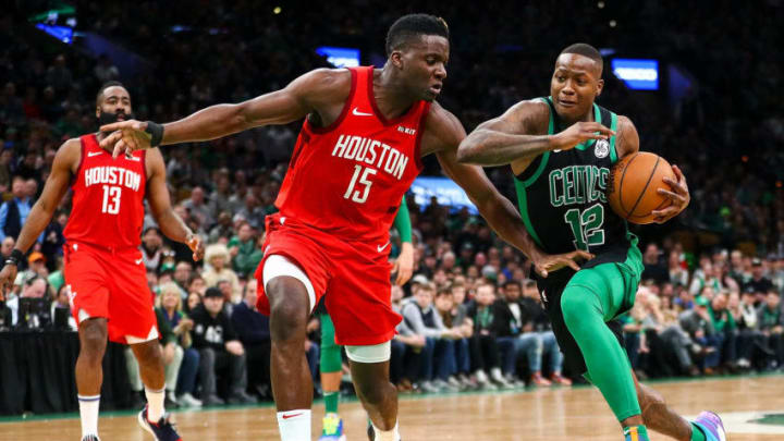 Terry Rozier #12 of the Boston Celtics drives to the basket past Clint Capela #15 of the Houston Rockets (Photo by Adam Glanzman/Getty Images)